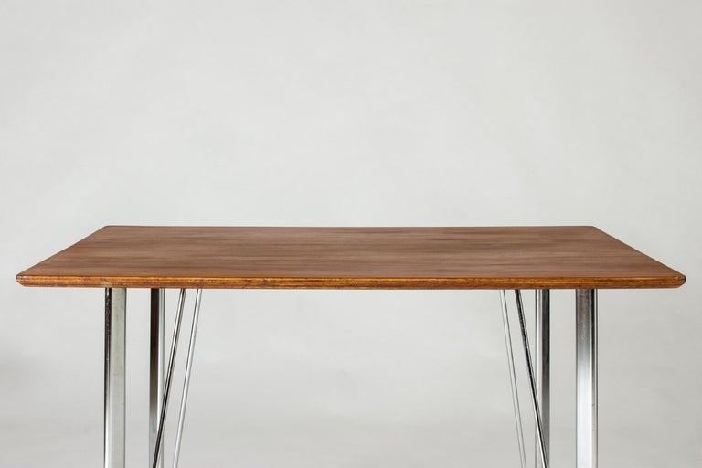Danish Steel and Teak Desk by Arne Jacobsen for Fritz Hansen. Denmark, 1960s For Sale