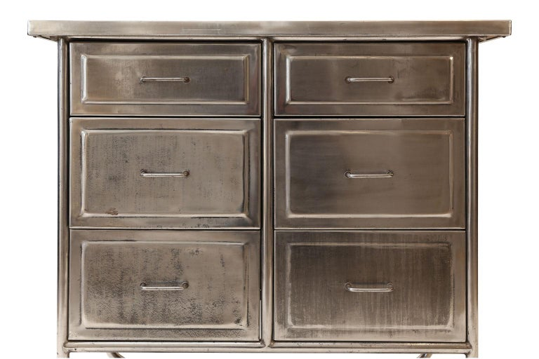 Steel chest of drawers, (circa 1930-1959). Midcentury six-drawer chest, or cabinet, in stainless steel with zinc alloy top. Possibly used in a doctor's office or in an Industrial setting.