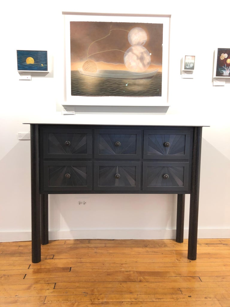 This totally functional piece of furniture is from hot-rolled steel. The panels on the drawer fronts and sides are created from strips of steel to create a starburst pattern. The drawers are designed with a simple screw style drawer-stop to keep