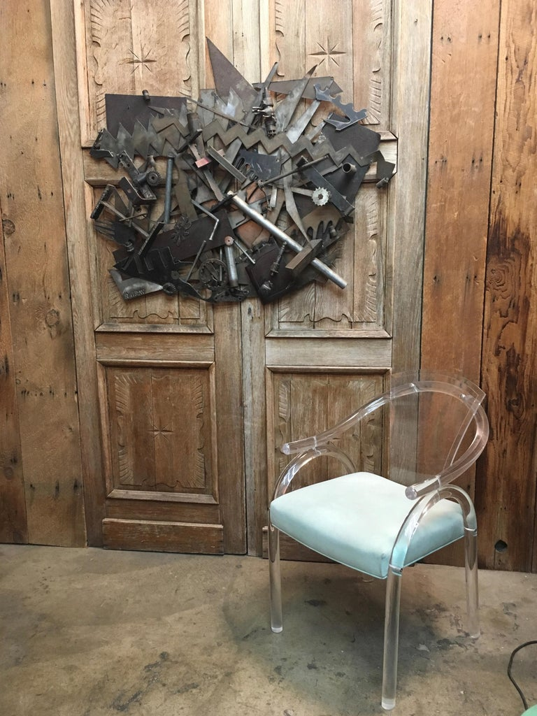 A mixture of nuts and bolts and scrap metal with gears welded together to make this Brutalist sculpture a real show stopper  Bruce Gray known for his art in many museums and private collections.