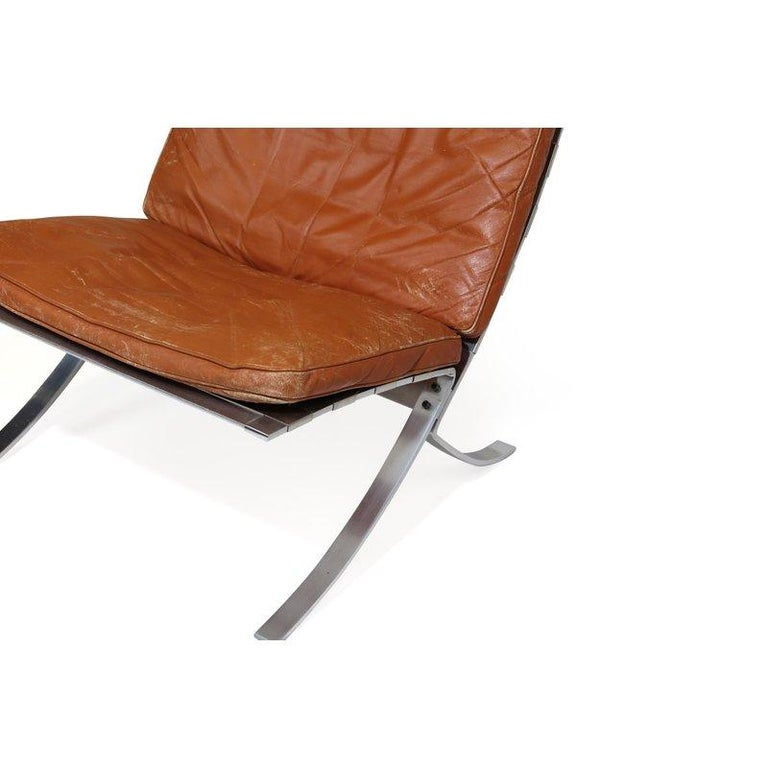 Danish Steen Ostergaard Steel and Leather Lounge Chair and Foot Stool For Sale