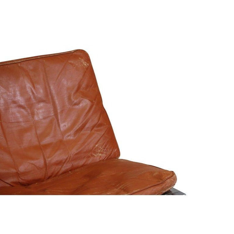 Steen Ostergaard Steel and Leather Lounge Chair and Foot Stool In Good Condition For Sale In Berkeley, CA