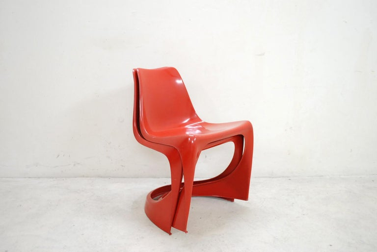Steen Ostergaard model 290 red plastic stacking chairs manufactured by Cado, 1970. Set of 2. With some scratches and marks.