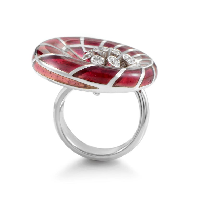 A daring design from Stefan Hafner, this majestic ring is made of prestigious 18K white gold marvelously embellished with striking crystal giving the piece its memorable offbeat appearance, accented with 0.46ct of sparkly diamond stones.