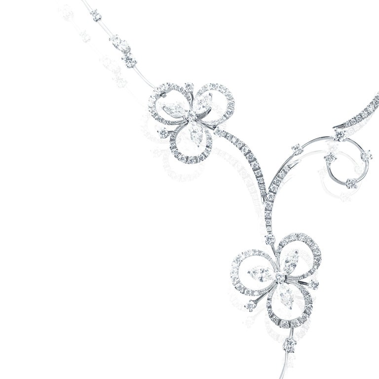 This Stefan Hafner 6.40 Carat 18kt White Gold Lucky Charm Diamond Necklace, is an exquisite and rare Diamond necklace boasting 6.40 Carats of Diamonds in an intricate and precious way.  A unique chain, somewhat similar to a long and short bulk