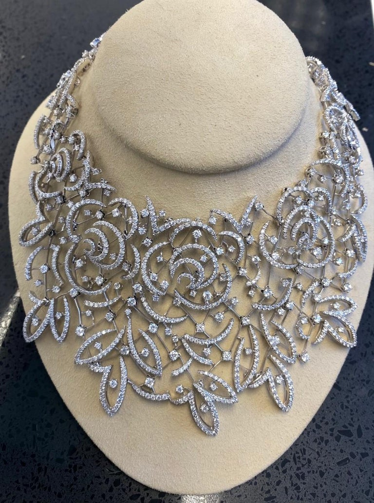Wear this necklace forthat specialevent. presented byStefan Hafner,crafted in solid 18K white gold. Meticulously executed exposing an immaculately rendered floral lacepatterncovered bygenuine extra whiteround-faceted diamonds of approx.