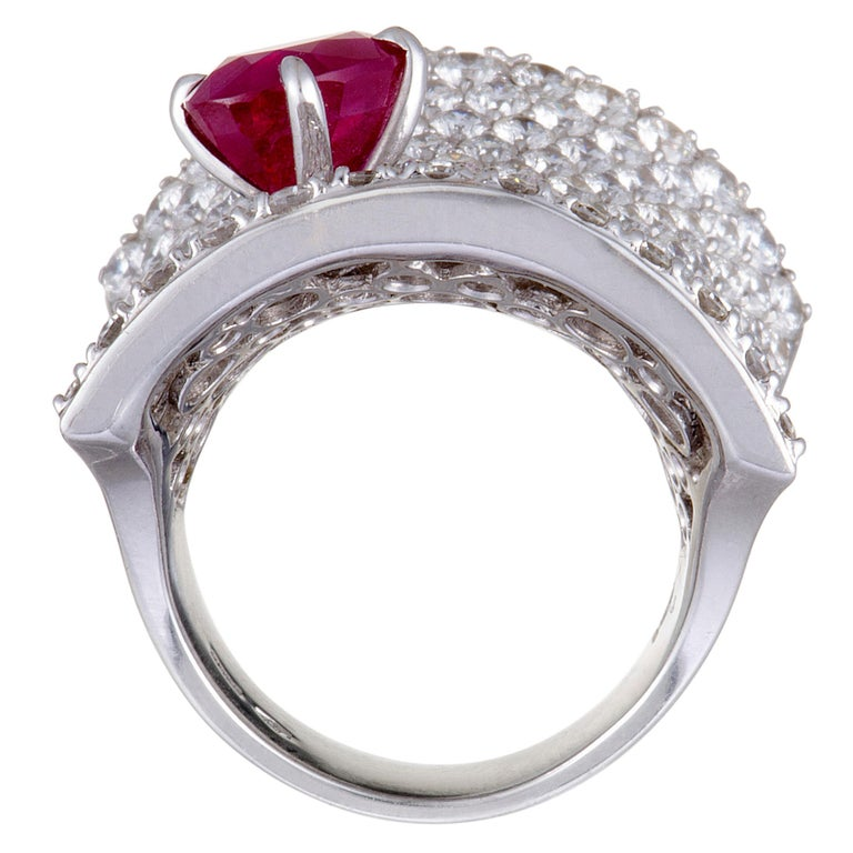 Elevate your style in a captivatingly luxurious fashion with this extraordinary statement piece from Stefan Hafner that is designed in an exceptionally prestigious manner and lavishly decorated with dazzling diamonds and with a striking ruby. The
