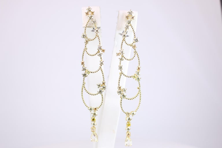 18K Yellow Gold Chandelier Earrings from renowned designer Stefan Hafner.  Sporting 1.62 C Yellow Diamond and 4.34 C White Diamonds.