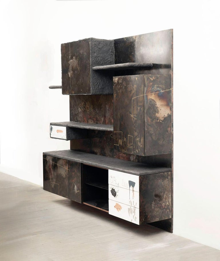 Stefan Rurak's encompassing wall unit typifies his unique approach to design. Designed as a fully integrated work, the wall is a flexible design, suitable as a bar, a dining room server, for the bedroom or office, or as an engaging focal point for