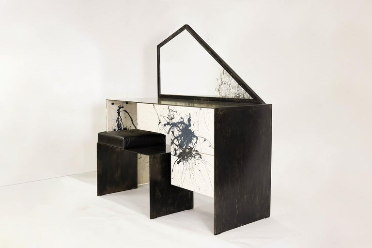 Stefan Rurak's dynamic vanity/desk typifies his unique approach to design. The work features a heavily patinated steel and bleached ash desk, topped by a trapezoidal mirror that has been acid etched to mimic the expressionist painted decoration. The