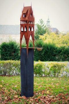 "Outdoor bird house - ""City Gate"" on a quadratic oxidised oak pedestal"