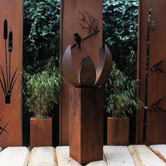 """German Steel Fireplace - """"Blossom I"""" - outdoor ornament - tall square base 80 cm"""