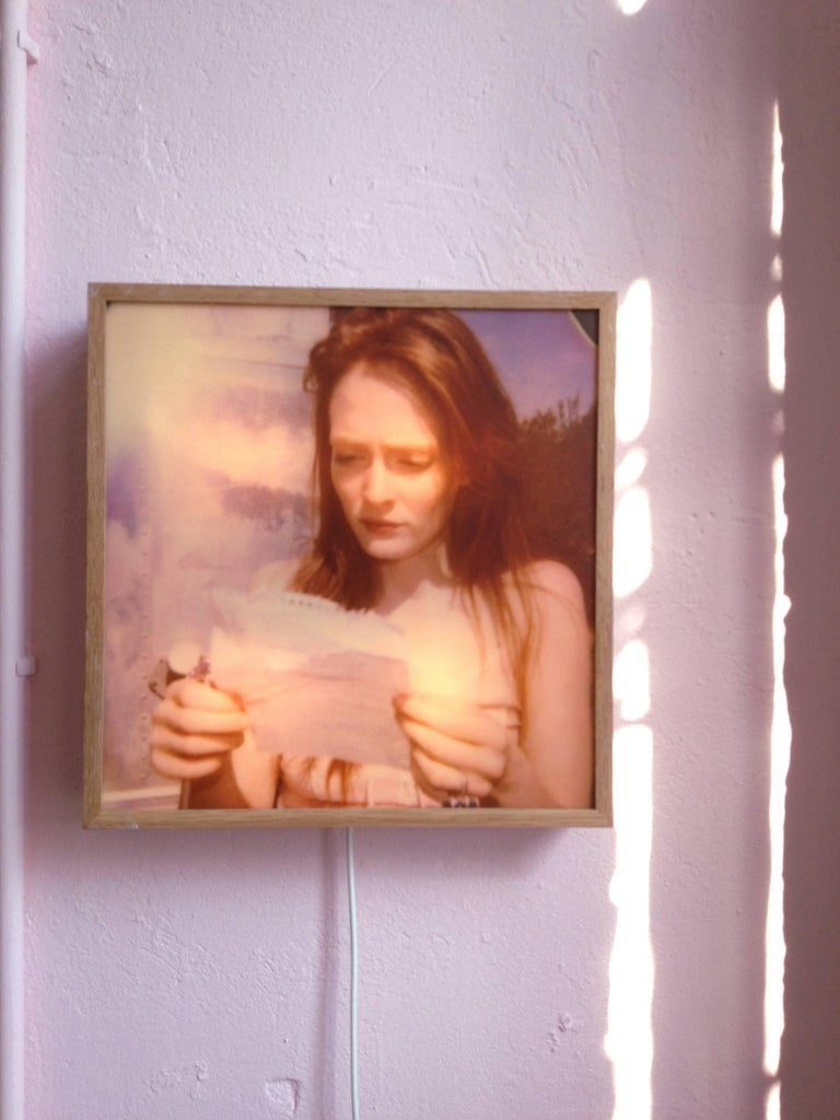 Stefanie Schneider's 'Lonely Hearts Room' lightbox 'Margarita's Letter' Edition 2/5, 45x45cm, 2008, based on a Polaroid with signature label and certificate, matte slight in oak frame Artist Inventory number 8848.22  This edition will be produced on