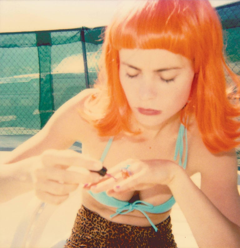 Stefanie Schneider Color Photograph - Radha doing her Nails by the Pool (29 Palms, CA) - Contemporary, Polaroid, Women