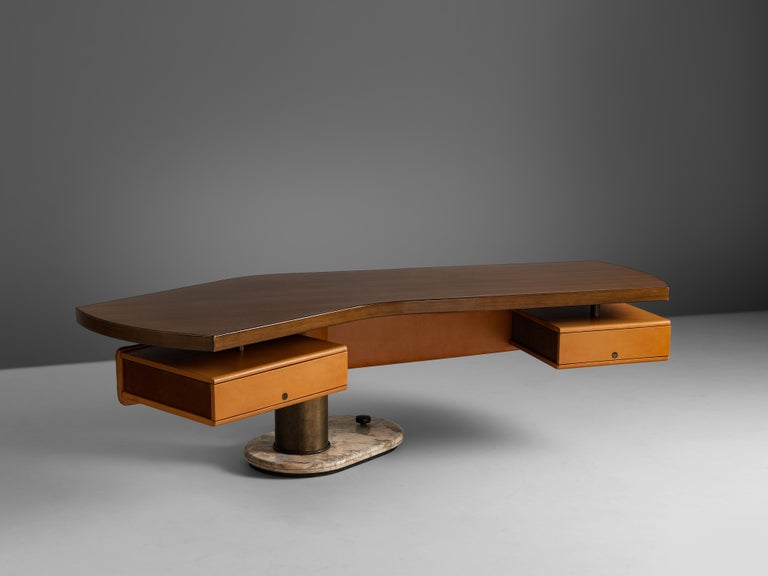 Stefano Mastuzzi,freestanding desk 'Zero',walnut, metal and marble, Italy, 1971-1972  This large, freestanding table with remarkable design was manufactured by Stefano Mastuzziin 1972. The boomerang shaped tabletop is held by one pedestal leg