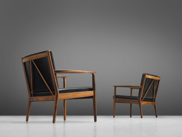 Steffen Syrach Larsen for Gustav Bertelsen, set of two armchairs, rosewood, leather, Denmark, 1961.  This set of sculptural easy chairs is designed by Steffen Syrach Larsen and made by Gustav Bertelsen. The rosewood chairs have a Minimalist,