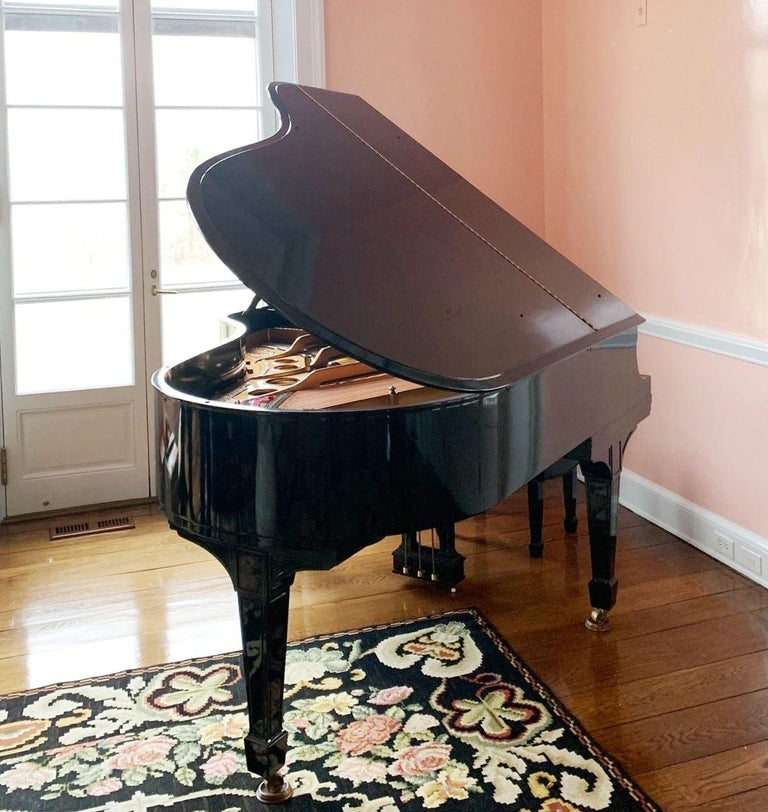 Art Deco period baby grand piano with matching leather tufted stool, made by Steinway & Sons in New York City. The piece has a black lacquered hardwood case and was made in circa 1920.