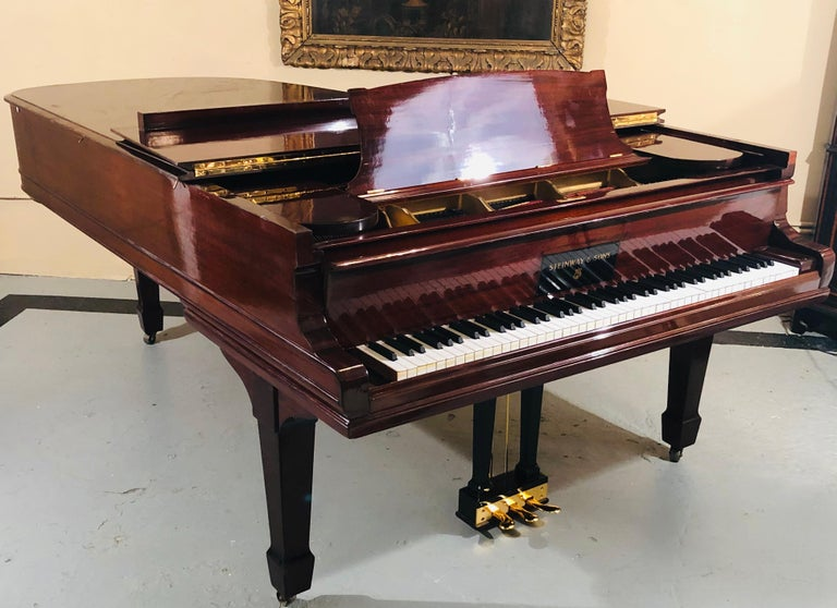Steinway Model B Classic Grand Piano 1901 in afully refinished mahogany case with polished brass. This finely refinished and partially rebuilt Steinway Piano is a Model B and left the Steinway Piano Workshop on September 2, 1901. The soundboard