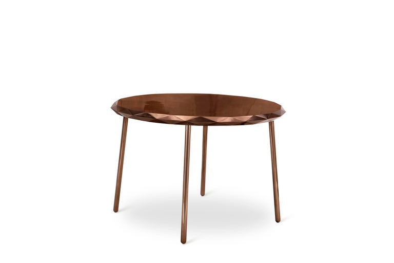 Stella Dining Table Rose Gold by Nika Zupanc is circular with starry edges and is an ideal table for four to dine on. Available in gold or rose gold.  Nika Zupanc, a strikingly renowned Slovenian designer, never shies away from redefining the status