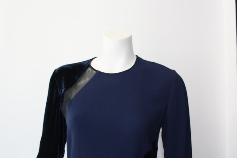 Stella McCartney long sleeve velvet and mesh navy gown. Contrasting navy toned panels. Concealed back zipper.  New with tags. Size IT 42