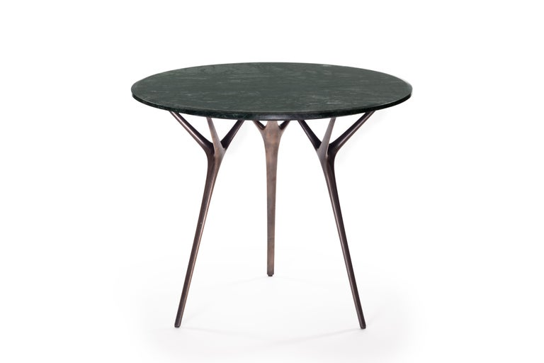 The biomorphic forms of the elegant Stellarnova legs are inspired by nature and sand cast in solid recycled bronze with a patinated finish. Designed with a triangulated attachment point, each leg is self-supportive with the tabletop, reducing