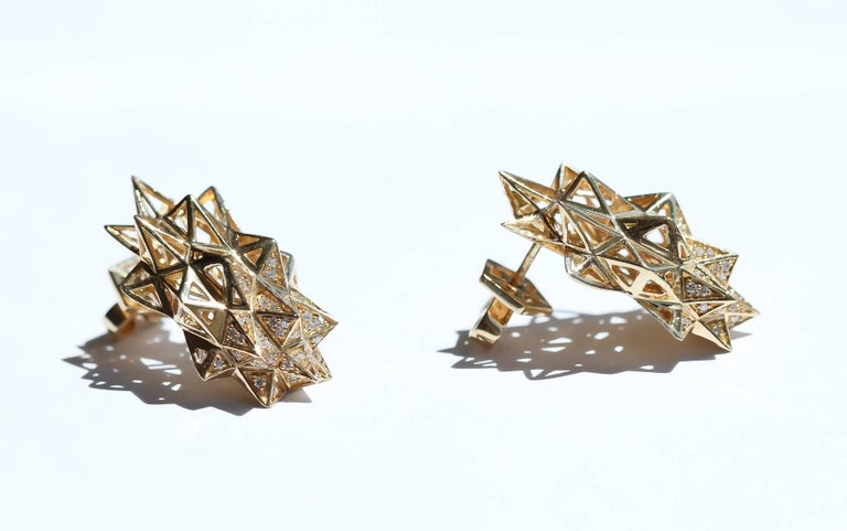 The gold Stellated star earrings were created using astrological algorithms based on the cosmos.   John Brevard applies his background in architecture and multidisciplinary arts to create ethereal designs that are not only visually stunning but also