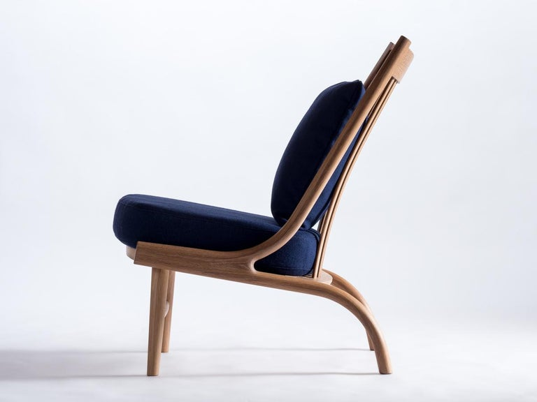 Featuring solid steam-bent hardwood and classic woven fabrics, the Stem lounge has appealing organic curves that flow into one another, cradling the user. The use of bent-wood components allows for a lighter profile that is incredibly sturdy and