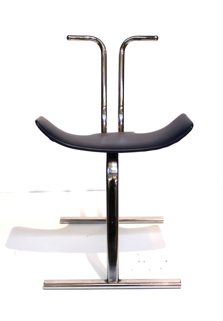 Scandinavian Mid-Century Modern stacking chair designed by Stendig Co. in the 1960s. The piece is made with a tubular chrome structure and can easily be stacked. Makers label on the bottom of the seat. In great vintage condition with age-appropriate