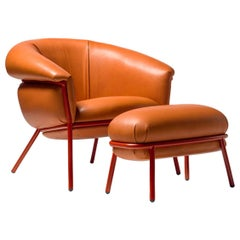 Stephen Burks Contemporary Grasso Orange Leather Armchair and Foot Stool