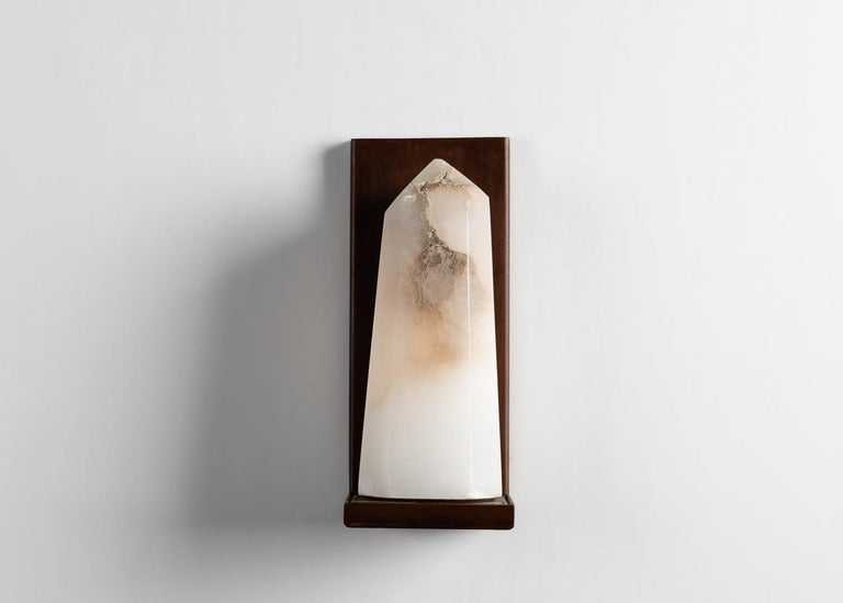 This elegant sconce by Stephen Downes, alabaster expert and student of Master Stone Carver René Lavaggi, is made of polished alabaster and patinated steel, and emits a soft light through its thick alabaster shade.