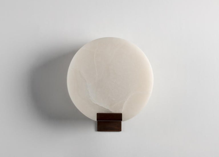 This elegant sconce by Stephen Downes, alabaster expert and student of Master Stone Carver René Lavaggi, mimics the moon in its shape, color, and with the soft light emitted through its thick alabaster shade.  Designed for one 60 watt bulb with a