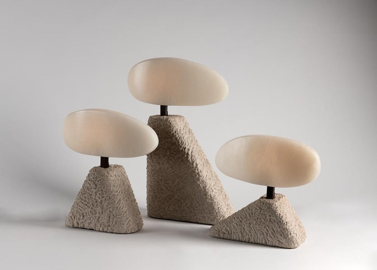 This set of table lamps by Stephen Downes, alabaster expert and student of Master Stone Carver René Lavaggi, are made of polished alabaster, patinated steel, and textured limestone and emit a soft light through their thick alabaster shades.  Small