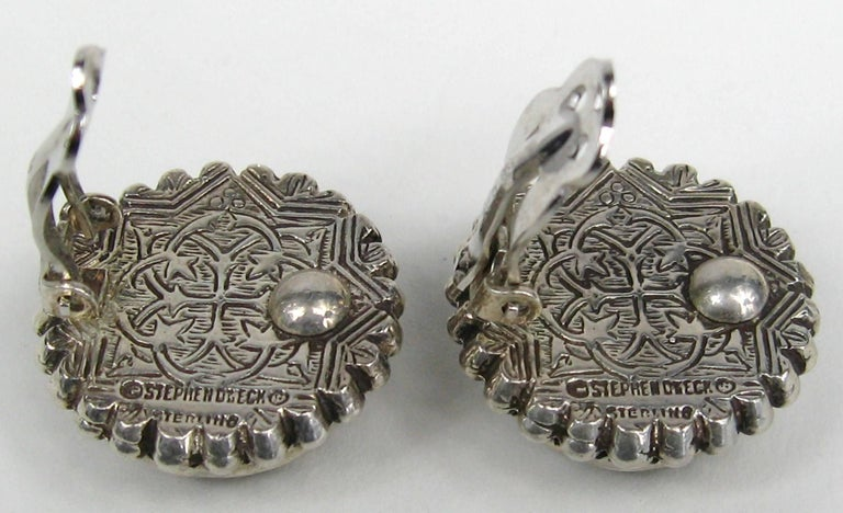Carved Jade Stephen Dweck earrings set in Sterling Silver. Still on original Neiman Marcus earring card, never worn. They measure 1 inch in diameter. Please be sure to check our storefront for more fashion as we have both Vintage and Contemporary