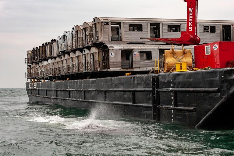 """C-Print Photograph, edition 2/5 signed on reverse by the artist, Stephen Mallon.  40""""x60""""  This photograph depicts a New York City Subway Train Car being dropped into the ocean to make an artificial reef.  This is from the New York photographer's"""
