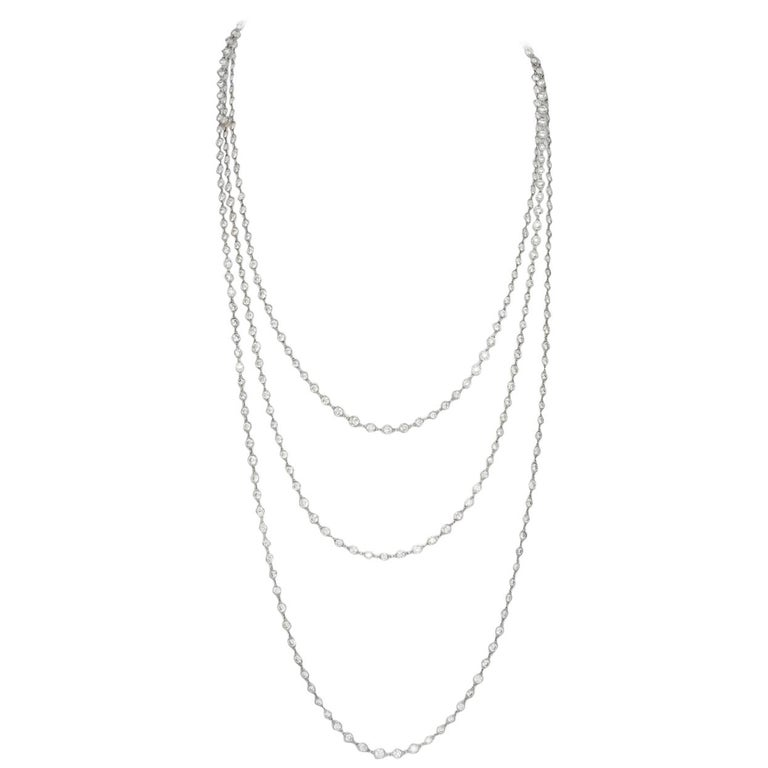 """This Stephen Russell Diamond and Platinum Chain is set with 324 Round Diamonds with a total weight of 76.15 ct; The length is 102"""". The focal point of this chain, beyond the beauty, is its versatility . The round brilliant cut diamonds of F - G"""