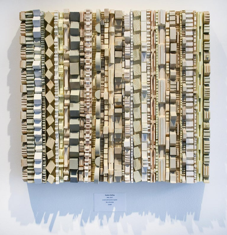 abstract three-dimensional wall sculpture, acrylic and wood on panel  carved pieces of wood painted in shades of white, grey and beige with an accent of mint green. 18 x 20 x 2.5 inches, can be oriented vertically or horizontally   Dynamic and