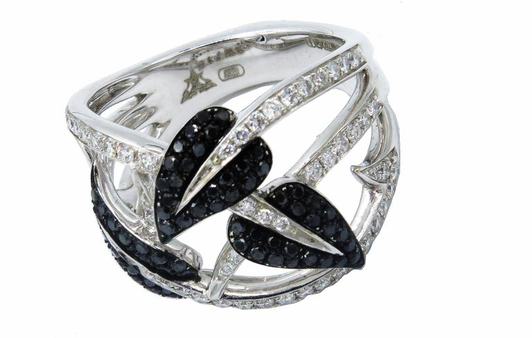Gorgeous Stephen Webster 18k white gold ring set with beautiful sparkling white and black pave diamonds. This unique ring design is from Webster's famous