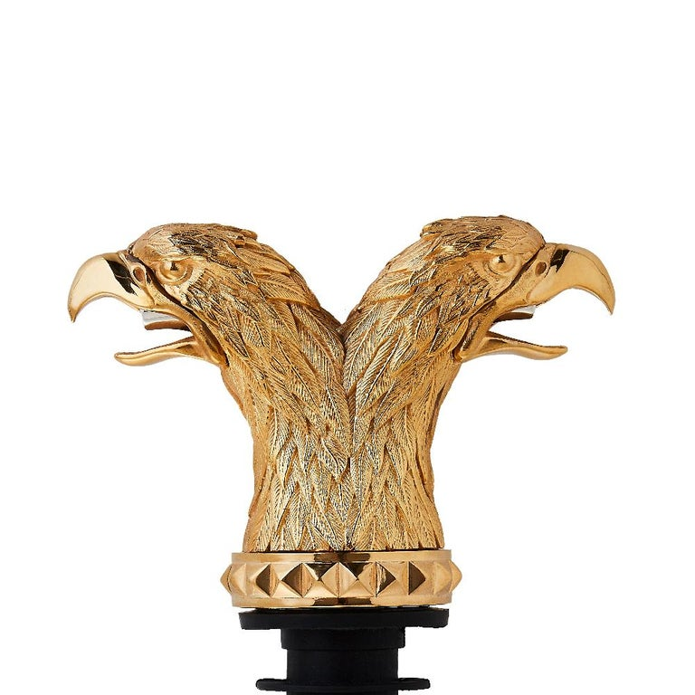 'Russian Roulette' is a set of intricate and expressive bar accessories inspired by the cupolas of Moscow's Saint Basil's Cathedral.  Double Eagle Head Pourer - Yellow gold plated bronze double eagle head pourer with double mouth spout.  Spanning