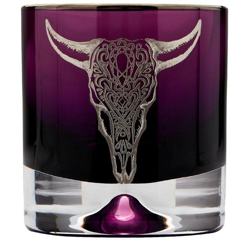 'Tequila Lore' is a set of bold and eye-catching bar accessories that celebrates Mexico's culture, folklore and famous tipple—tequila.  Lead crystal shot glasses and tumblers in either smoke or amethyst-colored glass, handmade in the UK, also