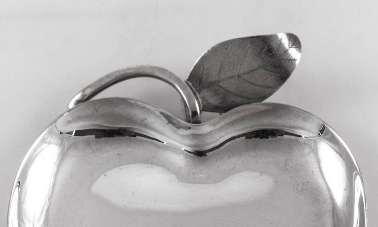 Just in time for the Jewish New Year, this beautiful sterling silver apple dish. It's shaped like an apple and even has the stalk and leaf. Fill it up with pomegranates or sweets, and remember to have a Happy and healthy New Year.