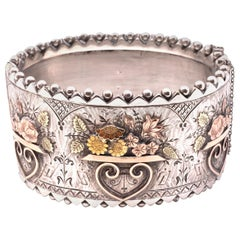 Sterling Bangle with Gold Flower Vases Accented in Rose and Yellow Gold