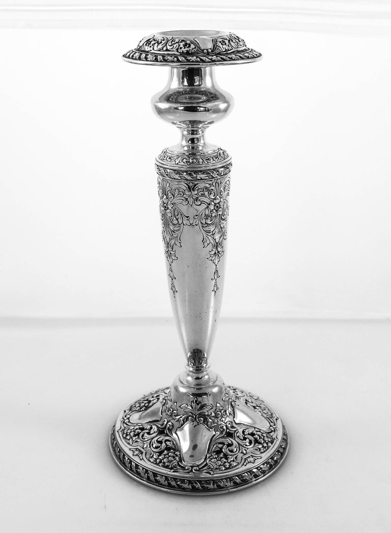 These exquisite sterling silver candlesticks are over one hundred years old and made by the Gorham Silver Company., Providence, RI. They are a work of art onto themselves. The detail along the base, body and bobeche is magnificent. Both the base and