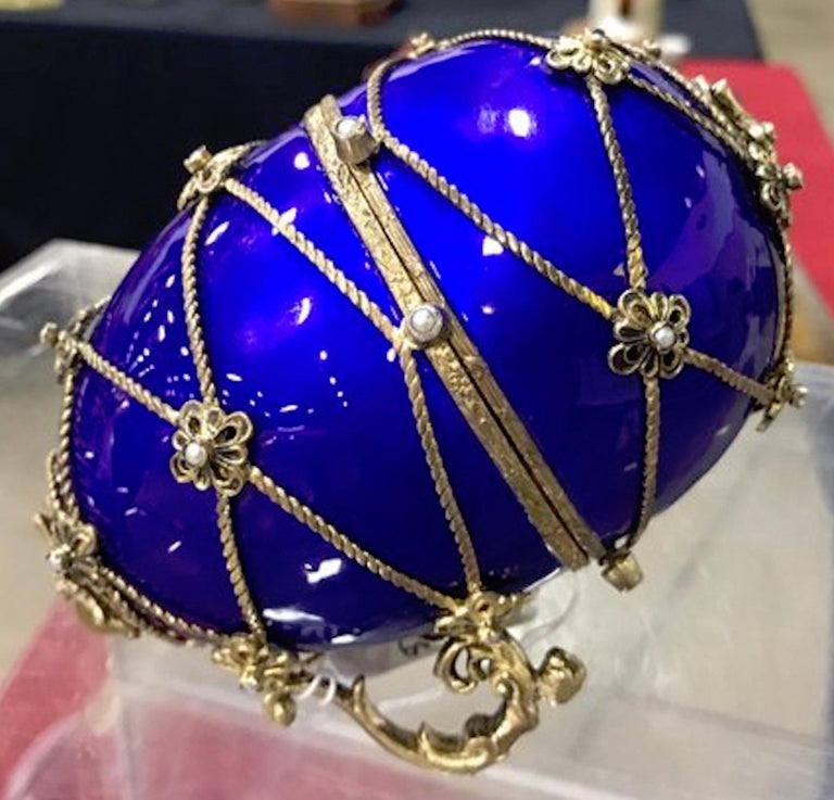 Sterling and cobalt blue enamel egg music box, in the style of Fabergé