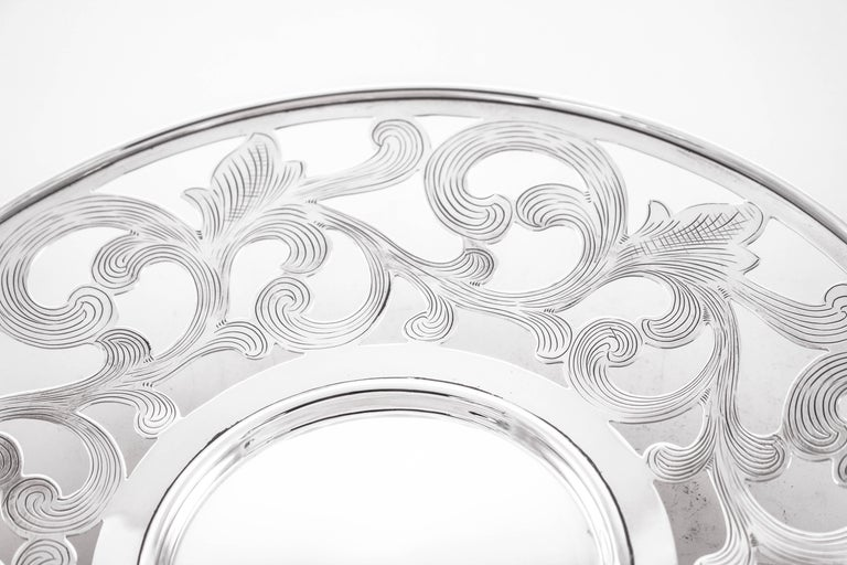 We are proud to offer this sterling silver reticulated dish on a pedestal. The perfect size and shape for casual entertaining. Swirls abound with fine etching on the inside. The pedestal is not weighted and lifts the dish off the surface.