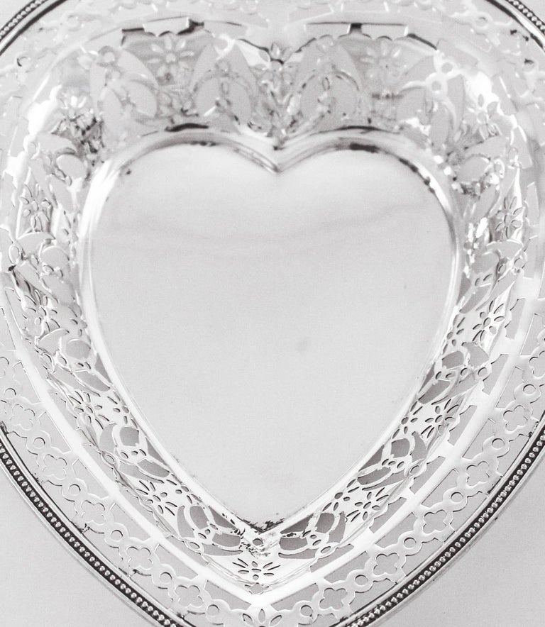This sterling silver heart-shaped dish is so pretty! It has a reticulated design that mixes beautifully with the plain center. Go ahead, tell that special someone how much you love them in a way they'll never forget.