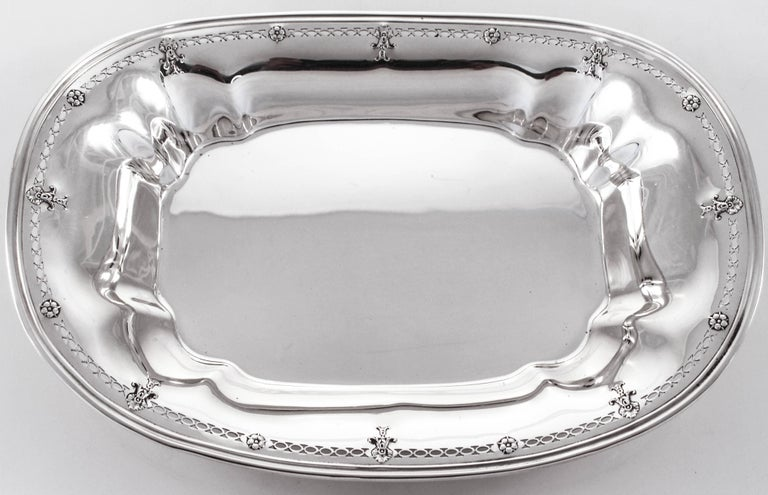 We are delighted to offer this lovely sterling silver dish by Reed & Barton. Oblong in shape with just a hint of detail around the edge, this piece promises to delight everyone's taste. There is an open-work pattern circling the rim with flowers
