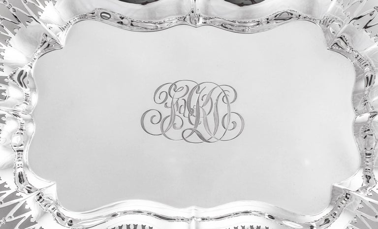 We proudly offer this sterling silver oblong tray by Black, Starr and Frost. It is reticulated and has an ornate rim that is also scalloped. In the center a hand engraved script monogram reminds you that although we've restored this piece to mint