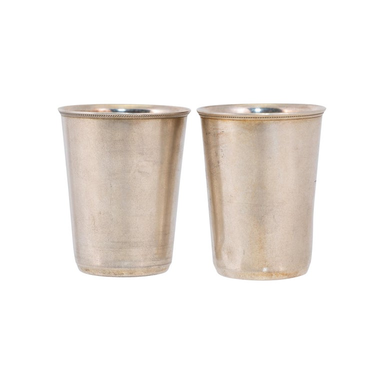 Matched pair Russian engraved sterling shot glasses.  PERIOD: Last quarter 19th Century ORIGIN: United States SIZE: 1 1/25