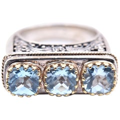 Sterling Silver 18 Karat Gold Accents Blue Topaz Three-Stone Engraved Ring