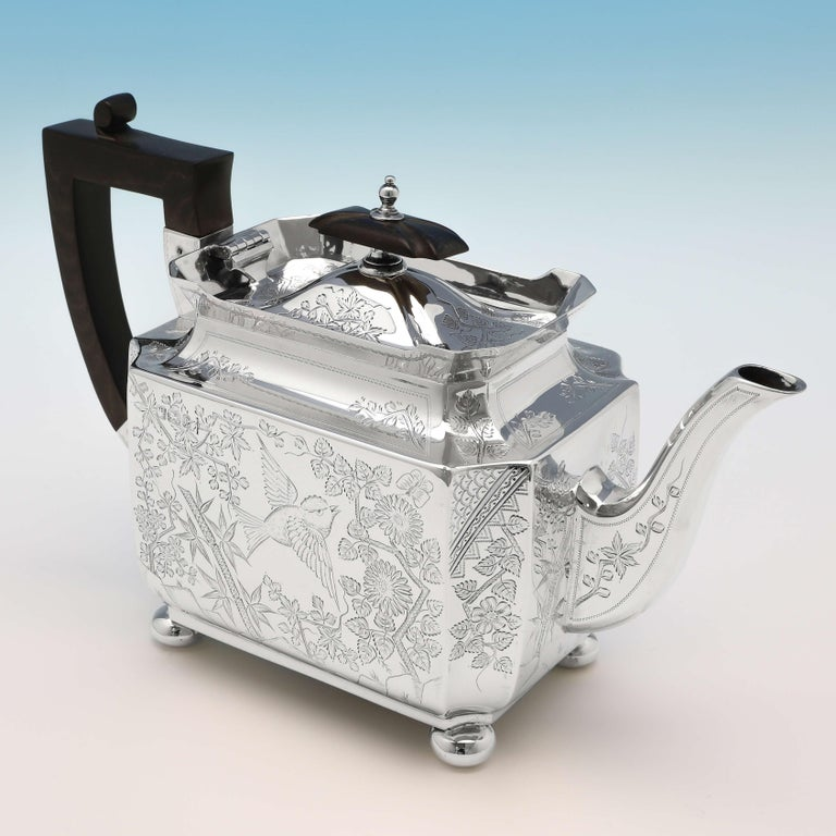 Hallmarked in Sheffield in 1895 by Walker & Hall, this exquisite, Victorian, antique sterling silver 3 piece tea set, is in the Aesthetic style, featuring wonderfully engraved decoration throughout. The teapot measures 6.25